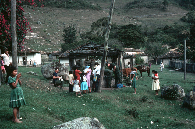 Residents of a mountain village receive medical attention from US Army personnel participating in the medical readiness training Exercise MEDRETE'85