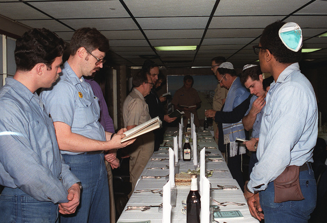 Crew members participate in the Jewish celebration of Passover aboard the nuclear-powered aircraft carrier the USS DWIGHT D. EISENHOWER (CVN 69)