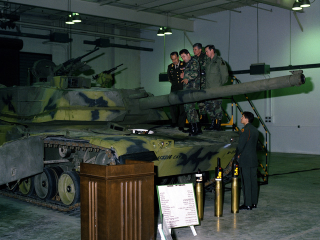 A U.S. Army officer discusses the M-1 Abrams main battle tank with Peruvian dignitaries visiting the U.S. Army Armor Center as GEN Frederick J. Brown, stands by in the background