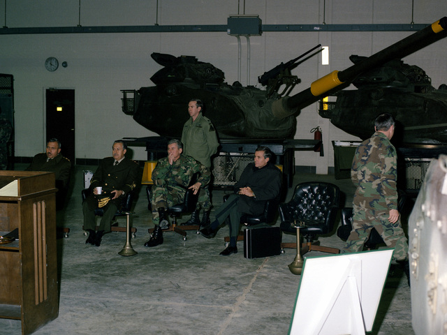 GEN Frederick J. Brown, center, listens to a presentation along with visiting dignitaries from Peru. The guests, who are visiting the U.S. Army Armor Center at Fort Knox, include: MAJ Gen Jose Vives, LT. COL Pedro Rivera and Gen of the Army German Figero. Standing by are U.S. Army SGT. 1ST Class Lopez and STAFF SGT. Vasquez-Gonzalez