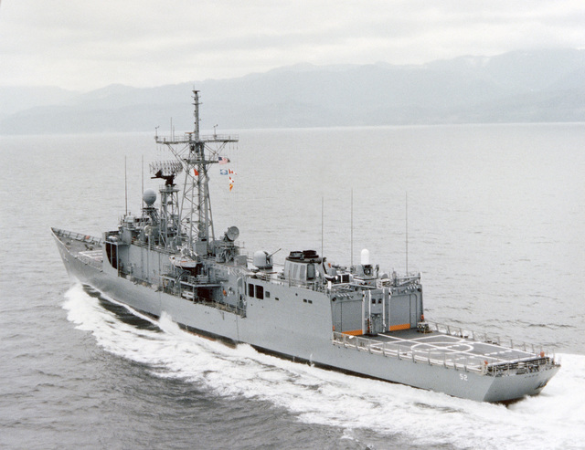 Aerial port quarter view of the Oliver Hazard Perry class guided missile frigate USS CARR (FFG 52) underway during builder's acceptance trials
