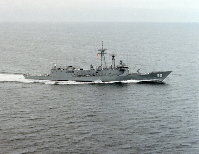Aerial starboard beam view of the Oliver Hazard Perry class guided missile frigate USS CARR (FFG 52) underway during builder's acceptance trials