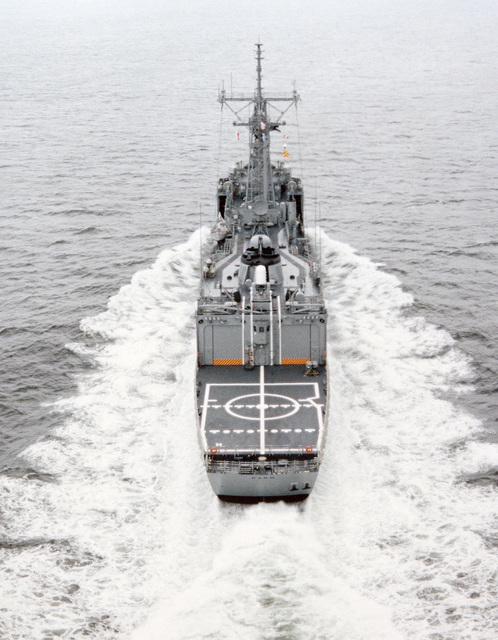 Aerial stern view of the Oliver Hazard Perry class guided missile frigate USS CARR (FFG 52) underway during builder's acceptance trials. (SUBSTANDARD)