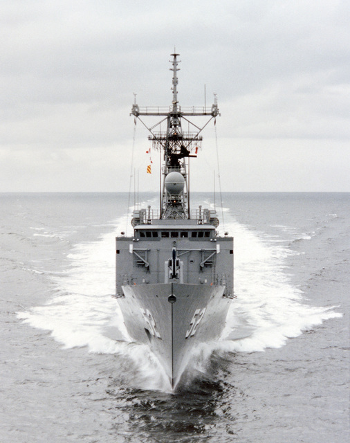 Bow view of the Oliver Hazard Perry class guided missile frigate USS CARR (FFG 52) underway during builder's acceptance trials