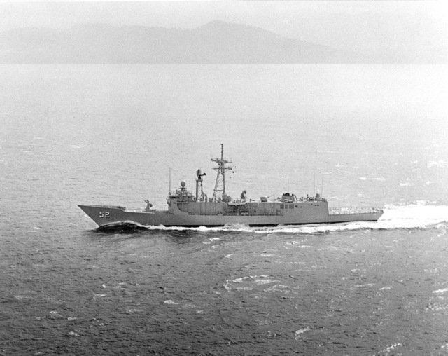 Elevated port beam view of the Oliver Hazard Perry class guided missile frigate USS CARR (FFG 52) underway during builder's acceptance trials. (SUBSTANDARD)