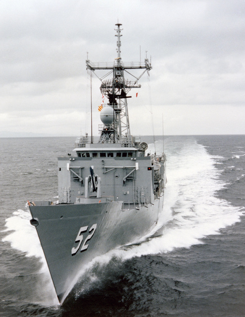 Low angle port bow view of the Oliver Hazard Perry class guided missile frigate USS CARR (FFG 52) underway during builder's acceptance trials