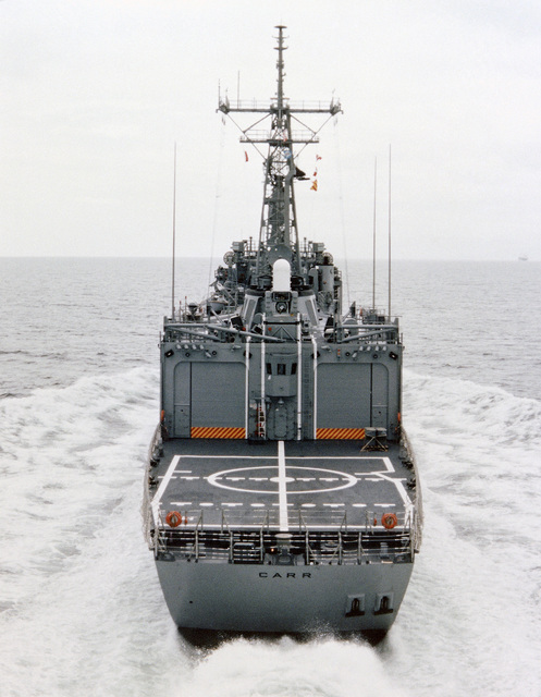 Low angle stern view of the Oliver Hazard Perry class guided missile frigate USS CARR (FFG 52) underway during builder's acceptance trials