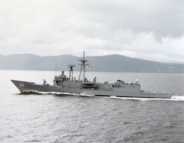 Port beam view of the Oliver Hazard Perry class guided missile frigate USS CARR (FFG 52) underway during builder's acceptance trials