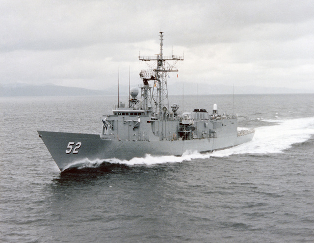 Port bow view of the Oliver Hazard Perry class guided missile frigate USS CARR (FFG 52) underway during builder's acceptance trials