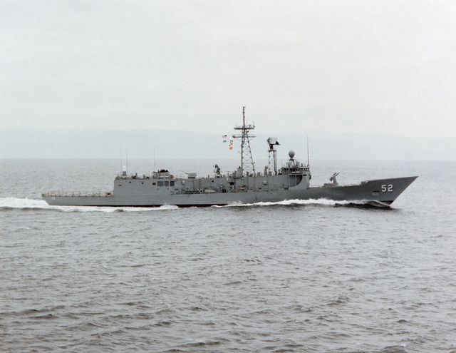 Starboard beam view of the Oliver Hazard Perry class guided missile frigate USS CARR (FFG 52) underway during builder's acceptance trials