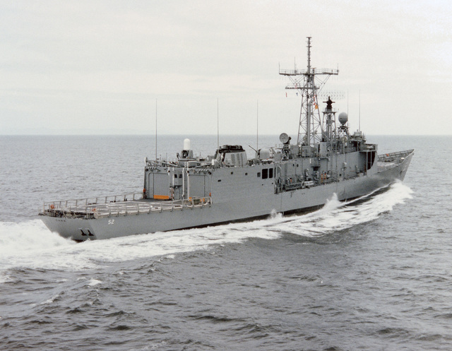 Starboard quarter view of the Oliver Hazard Perry class guided missile frigate USS CARR (FFG 52) underway during builder's acceptance trials