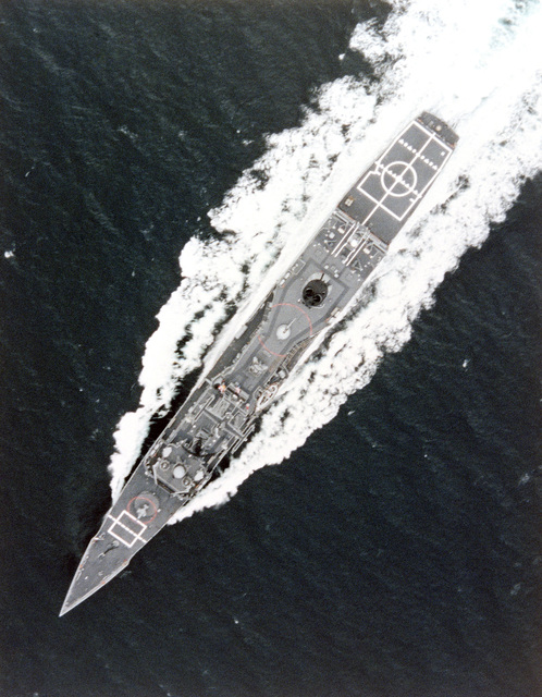 Vertical view of the Oliver Hazard Perry class guided missile frigate USS CARR (FFG 52) underway during builder's acceptance trials. (SUBSTANDARD)