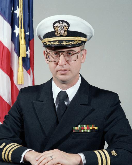 Commander (CDR) Ernest T. Taylor, USN (covered)