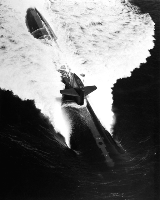 A high angle port bow view of the Los Angeles Class nuclear-powered attack submarine USS HONOLULU (SSN-718) underway