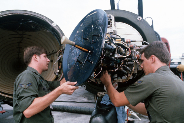 Airmen First Class (A1C) Ted Serafin and Andrew Acker of the 3rd Aircraft Generation Squadron work on the radar system of an US Air Force (USAF) F-4 Phantom II aircraftduring Theater Force Employment Exercise IV