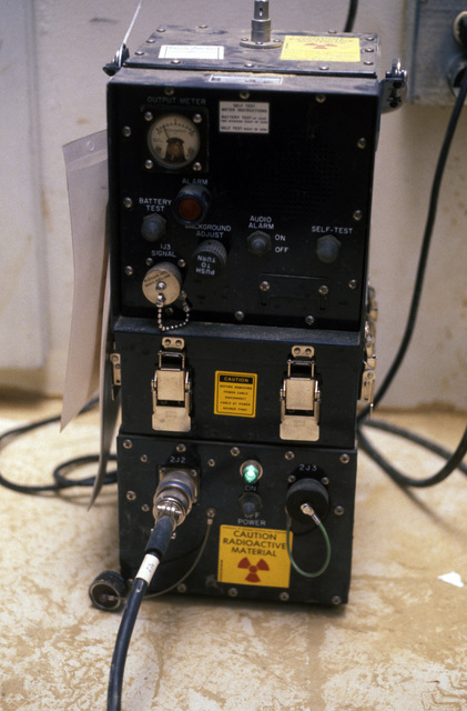 A close-up view of an automatic chemical detector being used by US Air Force personnel in survival collective protective shelter units during Exercise SALTY DEMO'85.  SALTY DEMO'85 is an air base survivability exercise evaluating passive and active defenses, aircraft operation and generation, and base recovery systems