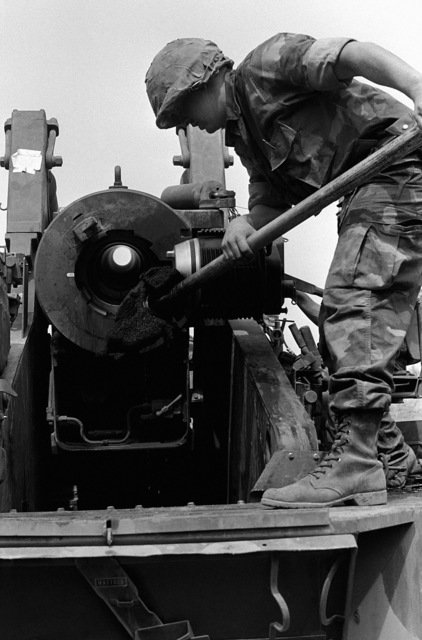 Lance Corporal (LCPL) Randy Abeyta, Battery P, 8th Tank Battalion, cleans the bore of a 155 mm self-propelled Howitzer during a field exercise