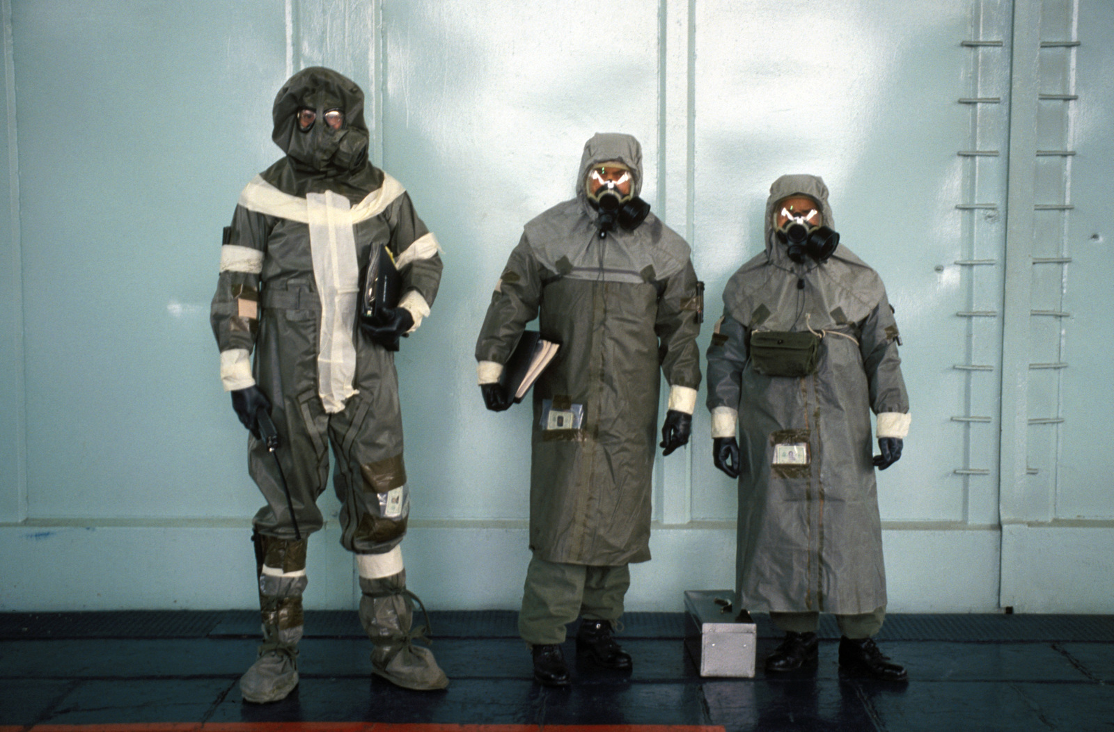 Members of the 52nd Tactical Fighter Wing wear various types of chemical warfare gear during Exercise SALTY DEMO'85.  SALTY DEMO'85 is an air base survivability exercise evaluating passive and active defenses, aircraft operation and generation, and base recovery systems