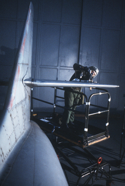 Technical Sergeant (TSGT) Jimmy May, 52nd Equipment Maintenance Squadron, attaches a metal plate to the stabilizer of a damaged aircraft during Exercise SALTY DEMO'85.  SALTY DEMO'85 is an air base survivability exercise evaluating passive and active defenses, aircraft operation and generation, and base recovery systems