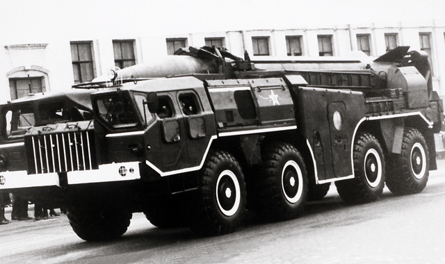 A left front view of a Soviet SS-1 (SCUD-B) battlefield support missile on a launcher/erector vehicle
