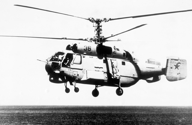 A left side view of a Soviet Ka-32 Helix helicopter in flight. From Soviet Military Power 1985