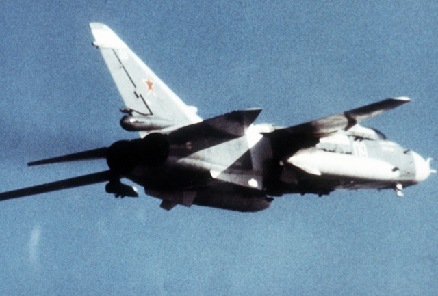 A right rear view of a Soviet Su-24 Fencer fighter-bomber aircraft in-flight