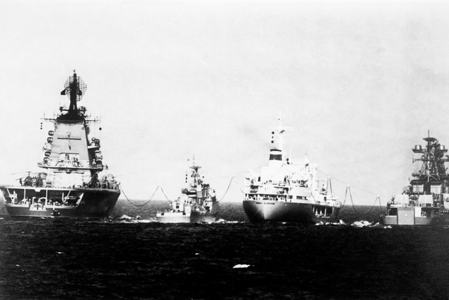 A stern view of Soviet ships during an underway replenishment operation. From left to right are the Soviet Moskva class helicopter cruiser LENINGRAD, a Soviet-built Cuban Koni class frigate, the replenishment ship IVAN BUBNOV and a Udaloy class guided missile destroyer. From Soviet Military Power 1985