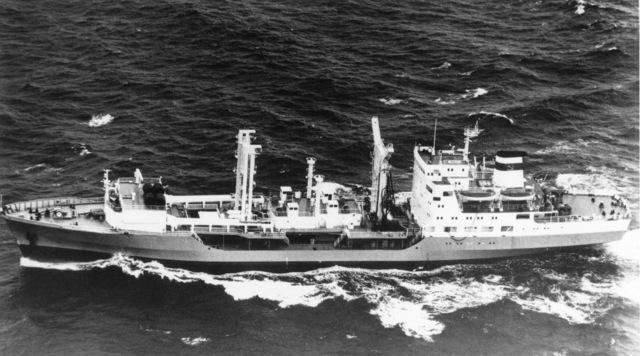 Aerial port beam view of a Soviet Dubna class replenishment ship underway