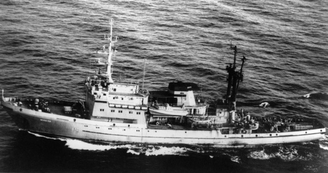 Aerial port beam view of a Soviet Ingul class salvage, rescue and mooring ship underway