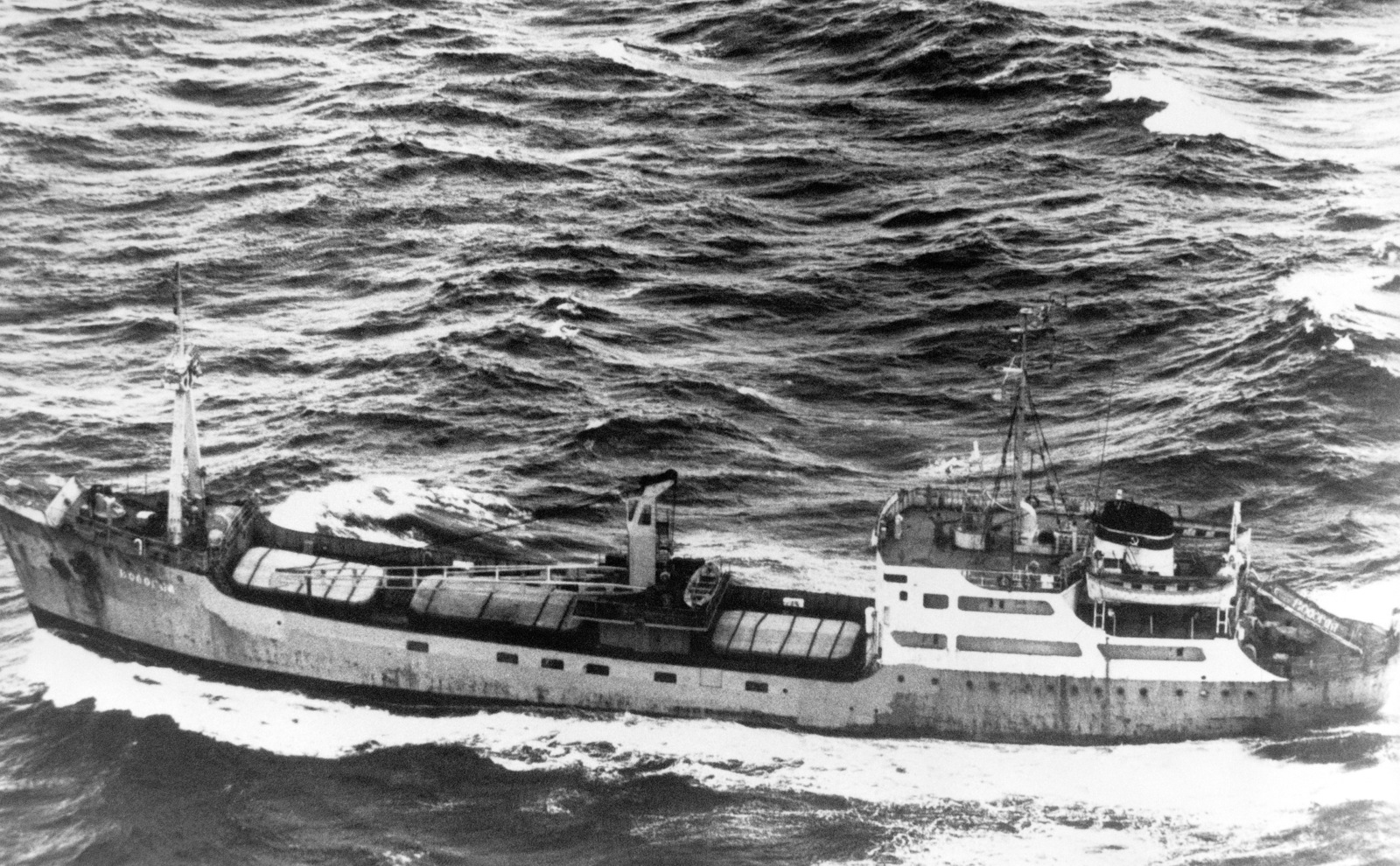 Aerial port beam view of a Soviet MP-6 class cargo ship underway