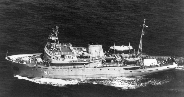 Aerial port beam view of the Soviet Pelym class degaussing ship underway