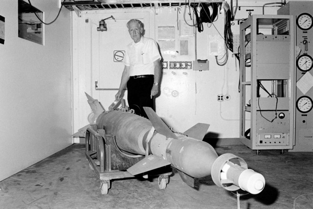 Engineer Dwight Weathersbee displays an AGM-123A Skipper II low-level, laser-guided bomb