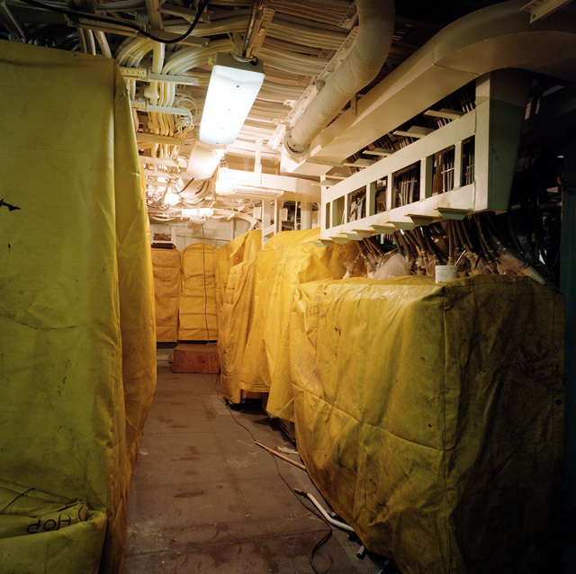 The radar, identification friend or foe, and combat information center equipment room aboard the guided missile frigate USS REUBEN JAMES (FFG 57) at 70 percent completion at the Todd shipyard