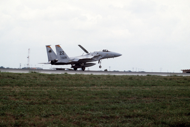 An F-15A Eagle aircraft lands on the runway after a mission