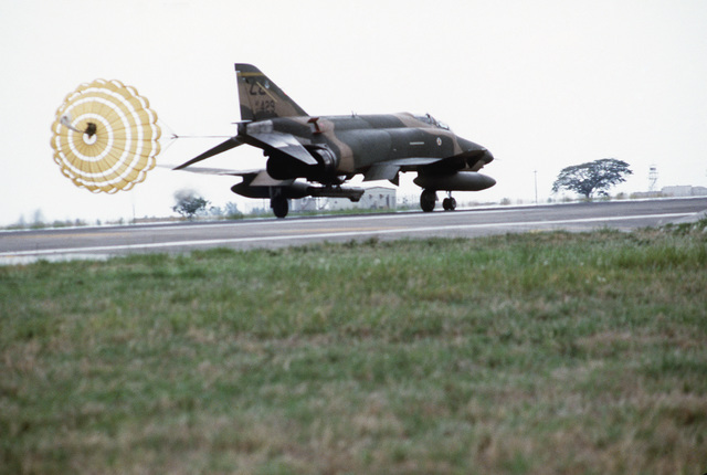 An RF-4C Phantom II aircraft deploys a drogue chute during a landing