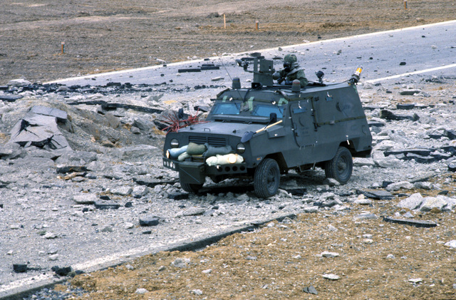 A member of the 52nd Civil Engineering Squadron examines a damaged runway from the top hatch of a Cadillac Gage Commando Ranger vehicle during Exercise SALTY DEMO'85.  SALTY DEMO'85 is an air base survivability exercise evaluating passive and active defenses, aircraft operation and generation, and base recovery systems