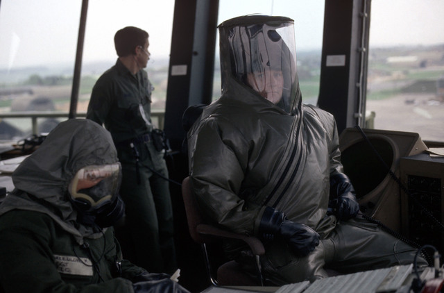 Air traffic controllers perform their duties in impermeable chemical defense protective esemble systems (IMPS) and chemical warfare gear during Exercise SALTY DEMO '85. SALTY DEMO '85 is an air base survivability exercise evaluating passive and active defenses, aircraft operation and generation, and base recovery systems
