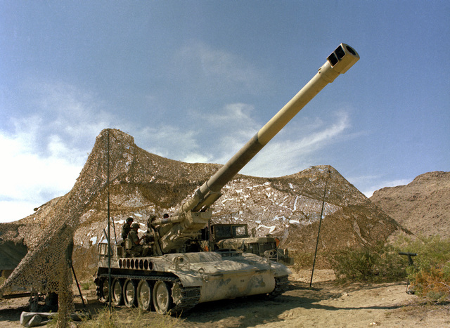 Camouflage netting covers an M-110 203mm howitzer during an exercise at the Marine Corps Air-Ground Combat Center