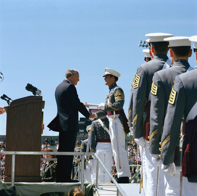 Secretary of the Army John O. Marsh hands out diplomas to the 1985 graduates of the US Military Academy