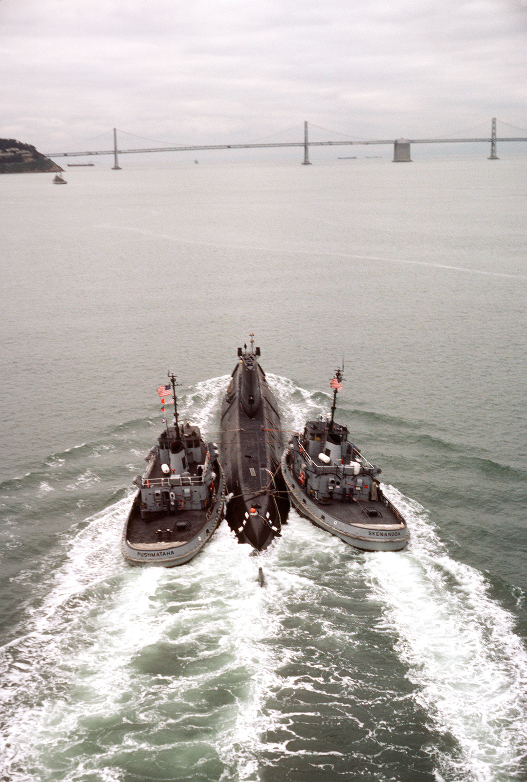 Aerial stern view of the nuclear-powered attack submarine ex-USS