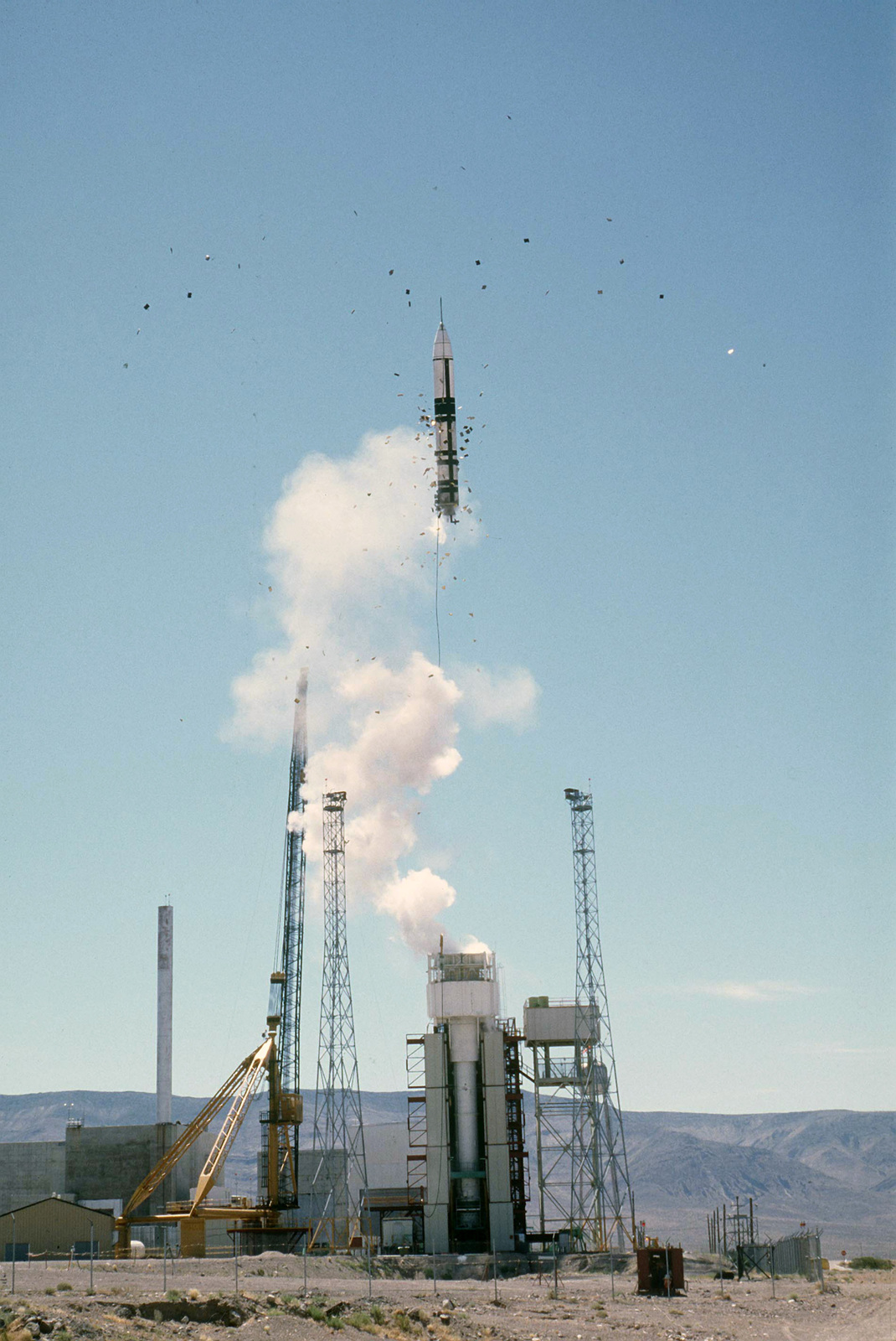 An LGM-118A Peacekeeper intercontinental ballistic missile is ejected from a launch canister during a test launch. (Third view in a series of four)