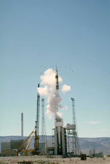 An LGM-118A Peacekeeper intercontinental ballistic missile is ejected from a launch canister during a test launch. (Second view in a series of four)