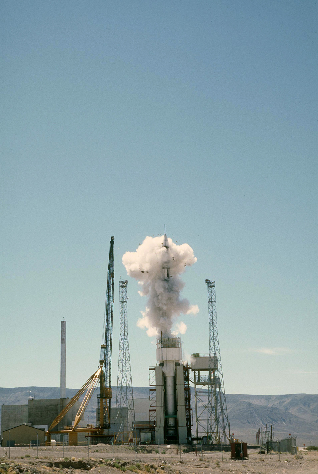 An LGM-118A Peacekeeper intercontinental ballistic missile is ejected from a launch canister during a test launch. (First view in a series of four)