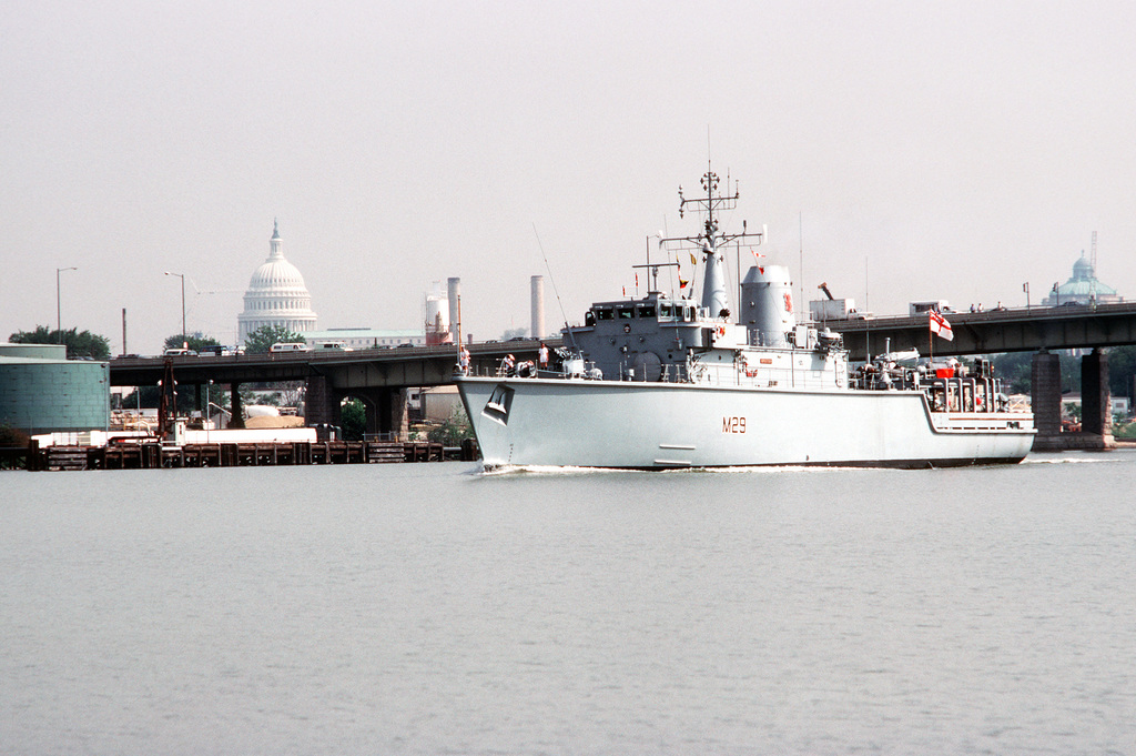 A port bow view of the British Hunt class minesweeper HMS BRECON (M 29) underway on the Anacostia River after departing from the Washington Navy Yard. The ship is part of the 1ST Mine Countermeasures Squadron. The US Capitol building is visible in the left background