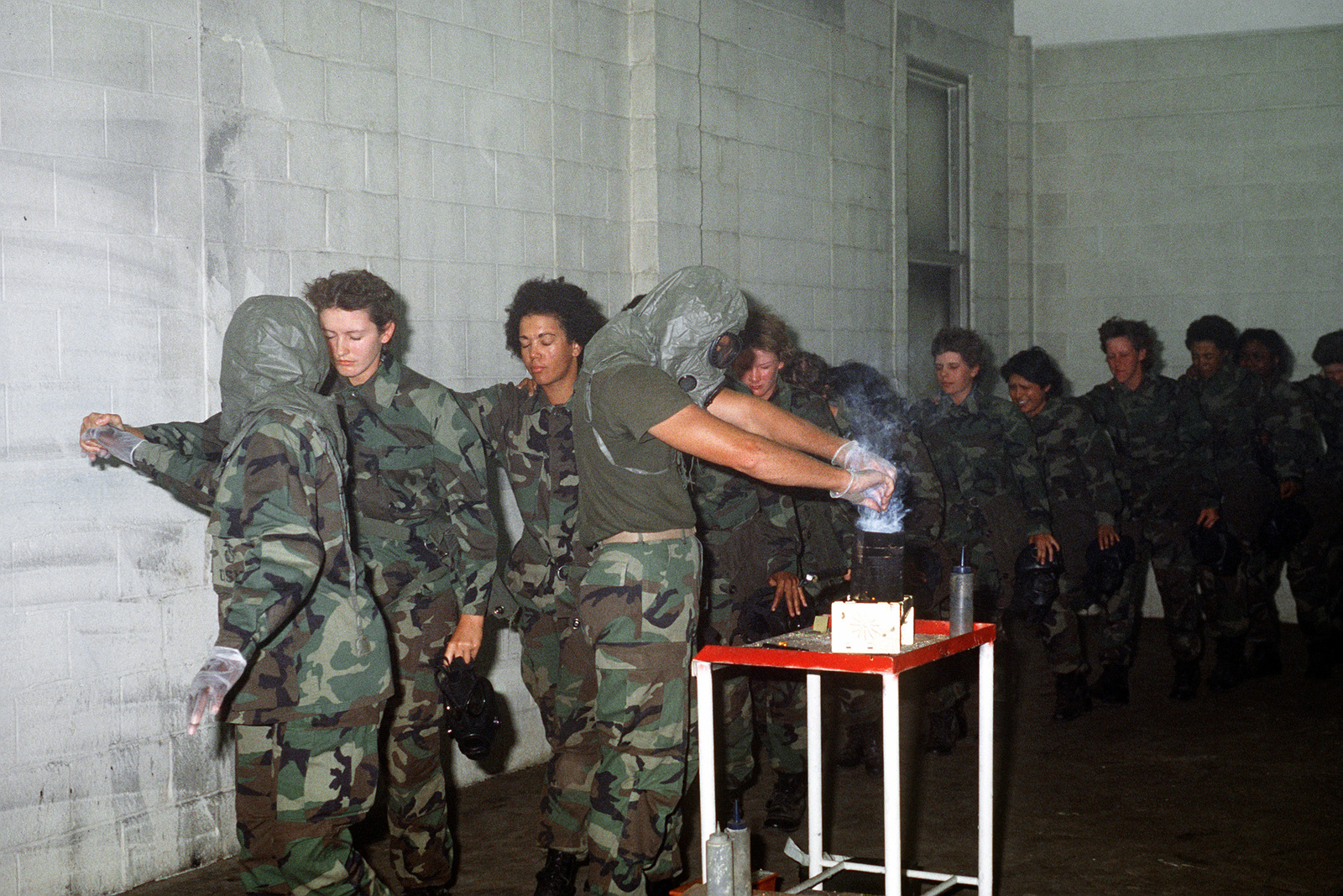 Women Marine recruits are exposed to tear gas during basic