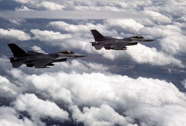 An air-to-air right side view of two 614th Tactical Fighter Squadron F-16A Fighting Falcon aircraft over Spain during a training mission
