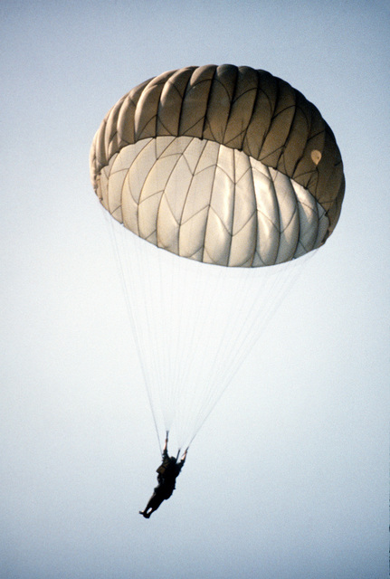 A competitor parachutes during the Volant Rodeo '84 tactical airdrop competition