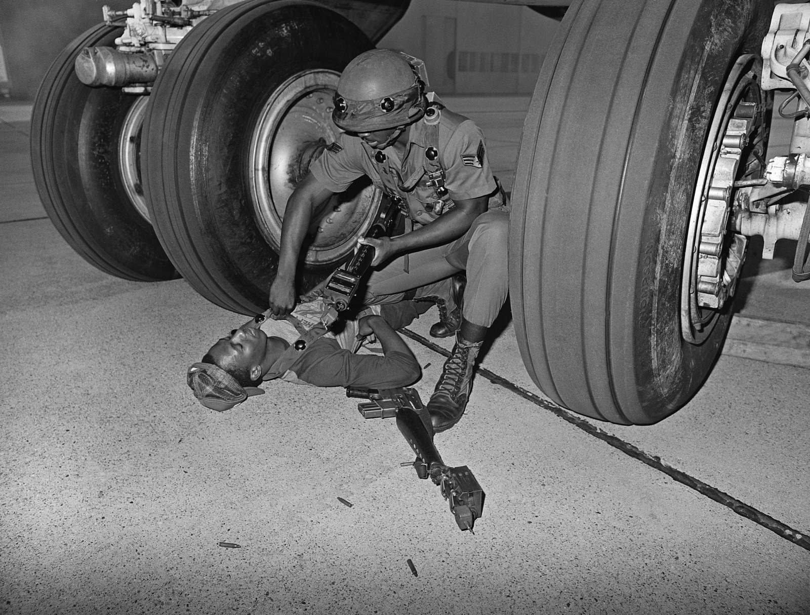 """Air Force security policemen apprehends an""""intruder""""while practicing security techniques in preparation for Mini Sword, an annual competition to increase combat readiness"""