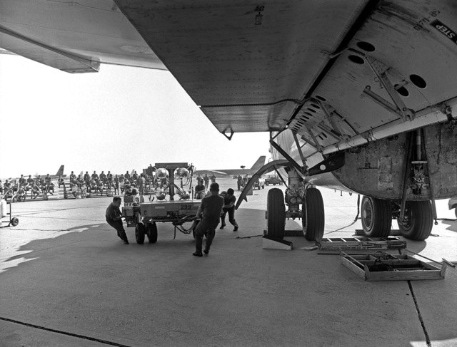An Air Force weapons loading crew practices loading ordnance onto a B-52 Stratofortress aircraft in preparation for Mini Sword, an annual competition to increase combat readiness