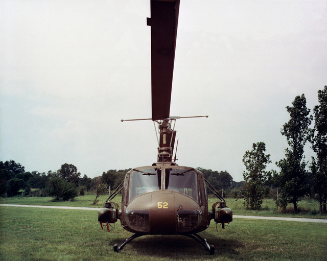 A front view of a UH-1 Iroquois helicopter equipped with an M-56 heliborne mine-dispensing system. A total of 160 mines can be carried in two reloadabel SUU-13A dispensers. The mines are ejected two at a time and a single sortie can lay down a minefield 100 meters long and 40 meters wide